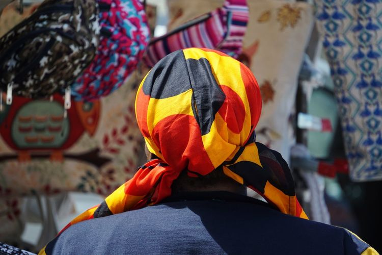 Rear view of man wearing colorful scarf