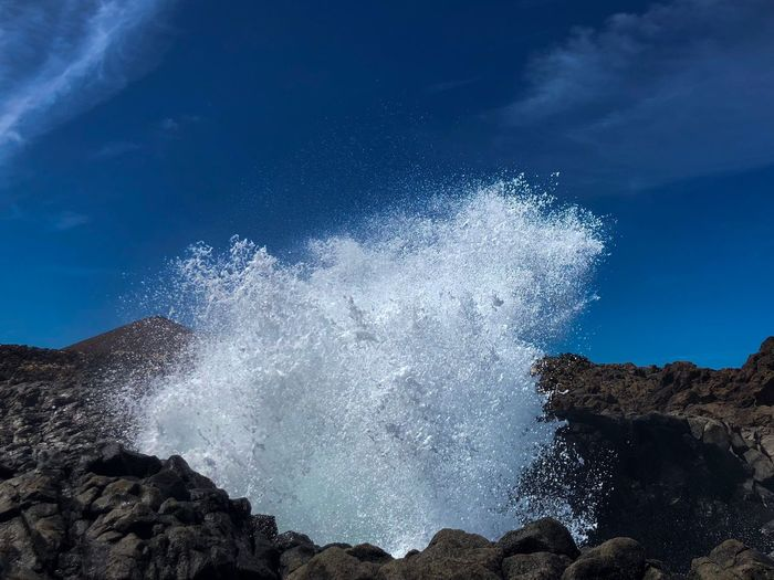 OceanBOOOOM Travel Photography Details Of Nature Splash BOOM! Wave Exploding Water Low Angle View Sky Blue Motion Nature Beauty In Nature Scenics - Nature Spraying Power In Nature Land Tranquility Rock Water Cloud - Sky Plant No People Tree Splashing Outdoors Day