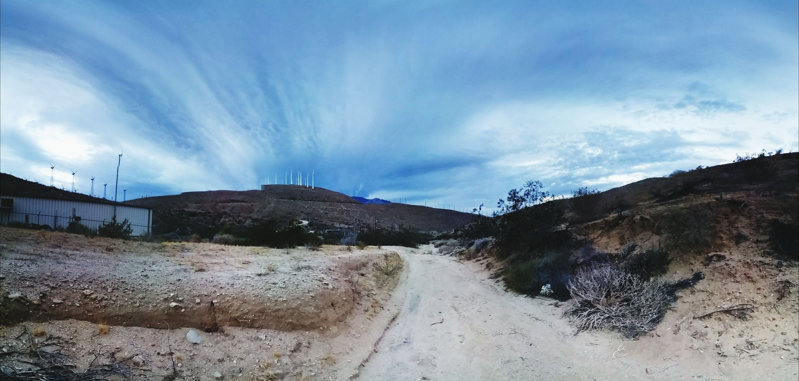 sky, cloud - sky, cloud, cloudy, the way forward, road, mountain, dirt road, built structure, landscape, building exterior, architecture, nature, house, tranquil scene, tranquility, weather, day, scenics, street