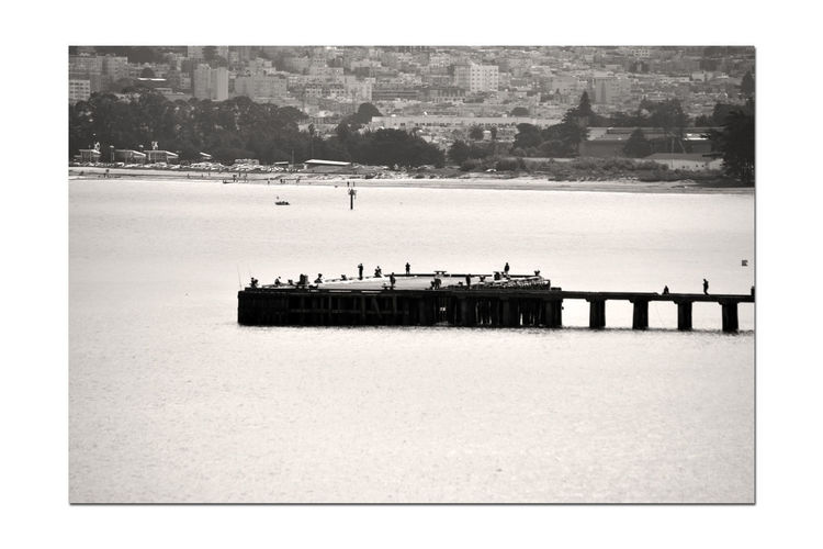 Torpedo Wharf 2 San Francisco CA🇺🇸 The Presidio Torpedo Wharf Pier People On The Pier San Francisco Bay Scenic Beach SF Marina District Cityscape West Bluff Bnw_friday_eyeemchallenge Bnw_pier Monochrome Lovers Monochrome Black & White Black & White Photography Sepia Black And White Black And White Collection  Landscape_Collection Bayview Nature In The City Landscape_photography Water Sea Tree Built Structure Residential District Urban Scene