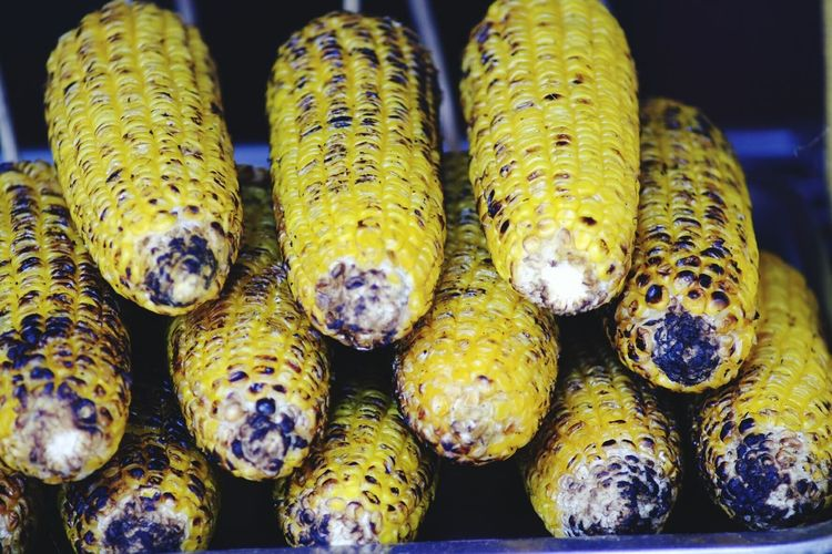 Close-up of roasted sweetcorns at market