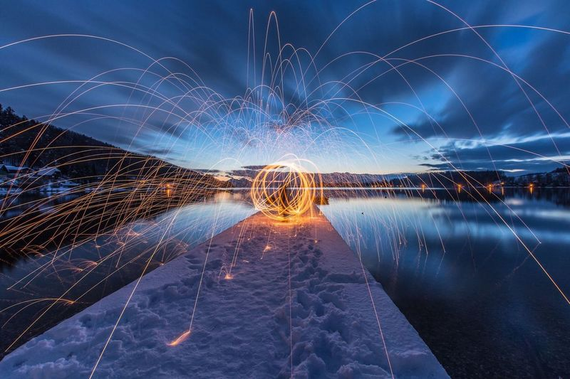 EyeEm Selects Long Exposure Illuminated Night Motion Wire Wool Light Trail Reflection Sky Sea Outdoors Nature Water No People Horizon Over Water Scenics Galaxy Astronomy