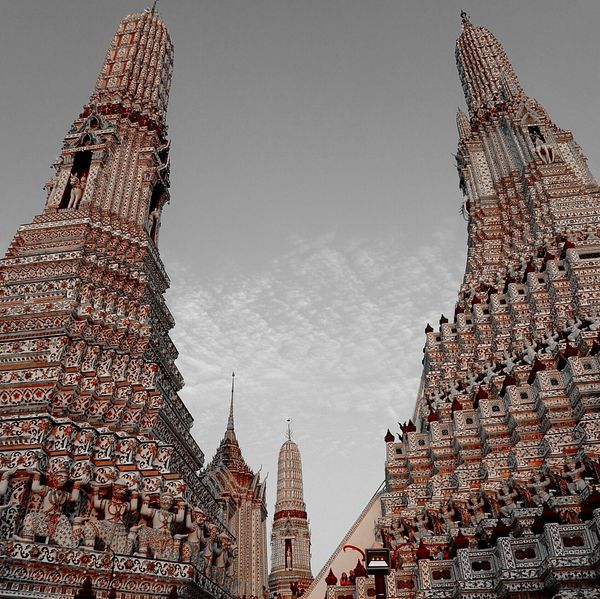 (Wat Arun) ..embracing Bangkok in a grey day From My Point Of View Wat Arun Bangkok Thailand. EyeEm Best Shots Ancient Spirituality Grey Sky Tower Towers Tourism Tourist Attraction  Buddhism Buddhist Temple Pink Bangkok Travel Photography Travel Destinations Built Structure ASIA Religion Cultures Building Exterior Temple Architecture Temples Thailand Architecture Temple - Building No People Day Sky City