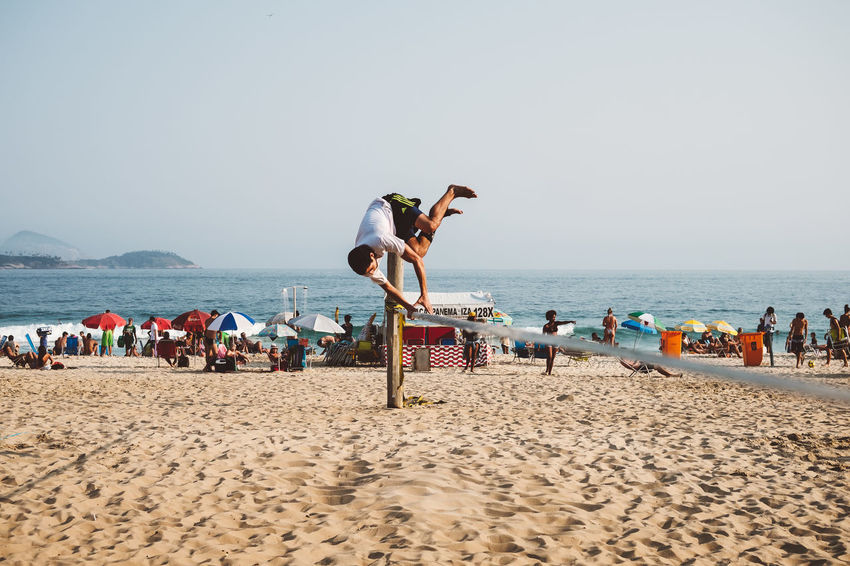 the slackline Beach Clear Sky Day Jump Outdoors People Real People Rio2016 Sea Sky Slackline Sport Vitality Water Young Adult