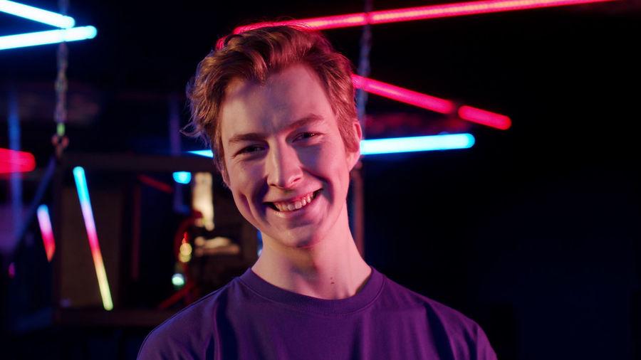 Portrait of smiling man in internet cafe