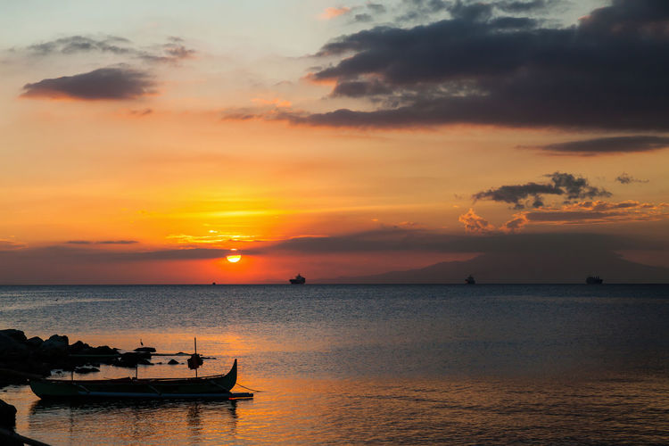 Sunset over Manila Bay, Philippines- Manila Manila Bay, Philippines Maritime Sunset_collection Cloud - Sky Dramatic Sky Idyllic Manila Bay Sunset Maritime Photography No People Orange Color Outdoors Scenics Scenicsunset Sea Ship Shipping  Silhouette Sky Sun Sunset Tranquility Transportation Vessel Water