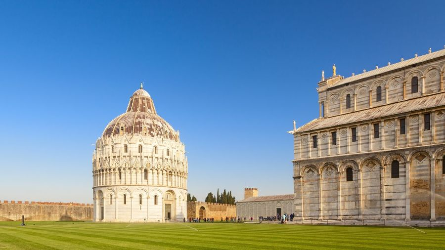 Pisa Cathedral And Baptistery Against Clear Blue Sky