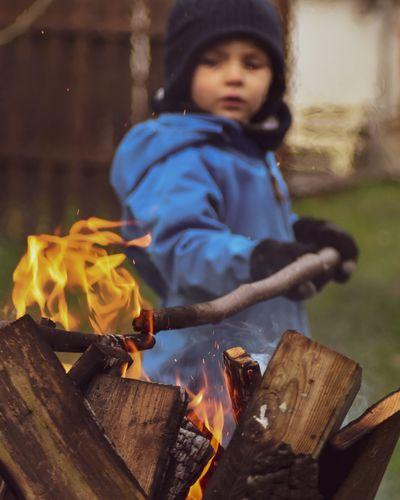 Boy burning wood