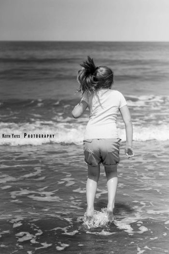 Watching my kids do this, brings back so many childhood memories of wave jumping with my sister. Good times. Waves Jumping The Waves My Beautiful Daughter Beach British Summertime Seaside Norfolk Uk EyeEm Best Shots - Black + White