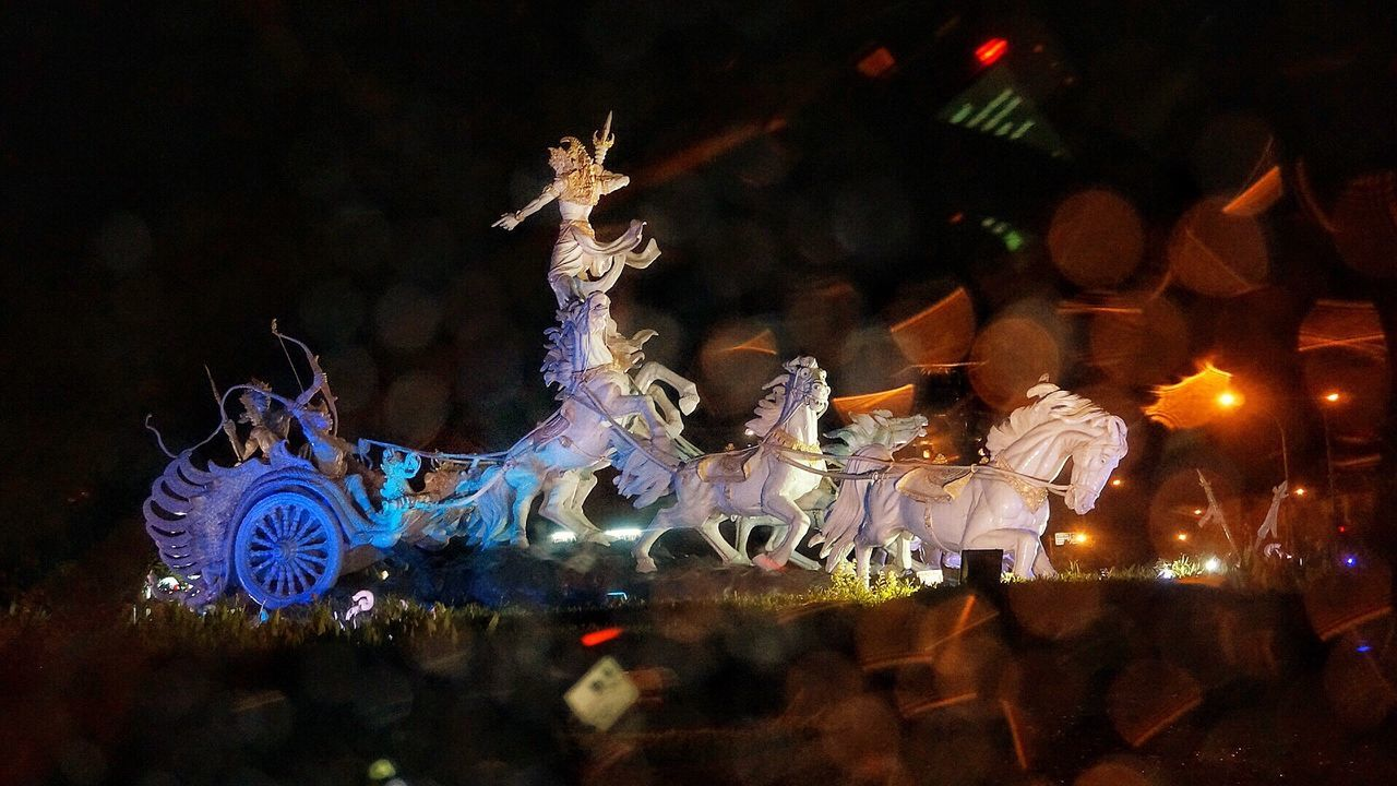 night, human representation, christmas decoration, illuminated, christmas, sculpture, celebration, no people, outdoors, statue