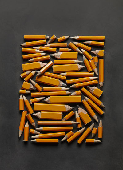 High Angle View Of Broken Pencils On Black Background