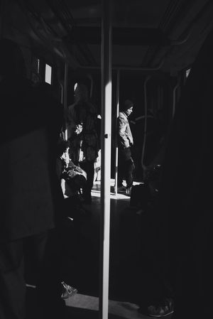 Black And White Friday Real People Public Transportation Indoors  Women Men Rail Transportation Train - Vehicle Lifestyles Standing Leisure Activity Sitting Occupation Subway Train Day Adult People One Person Adults Only Light And Shadow Mobilephotography