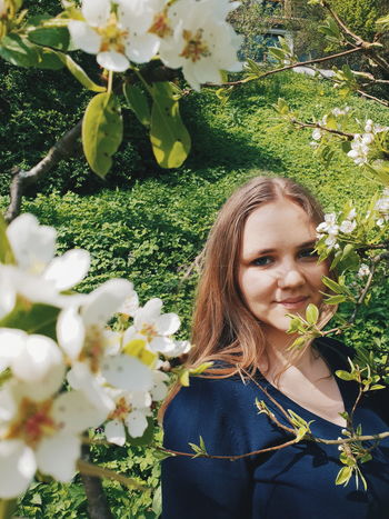 inbetween the flowers Young Women Beautiful Woman Flower Tree Portrait Smiling Happiness Beauty Blond Hair Women Blooming Wearing Flowers In Bloom Blossom Flower Head Cherry Blossom Apple Blossom Petal Botany Growing Growth