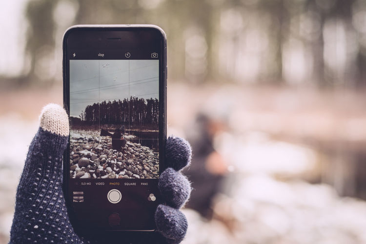 Framing Shot Gloves Holding Phone Off The Highway Photo Of Woman Smartphone Taking Photos Winter