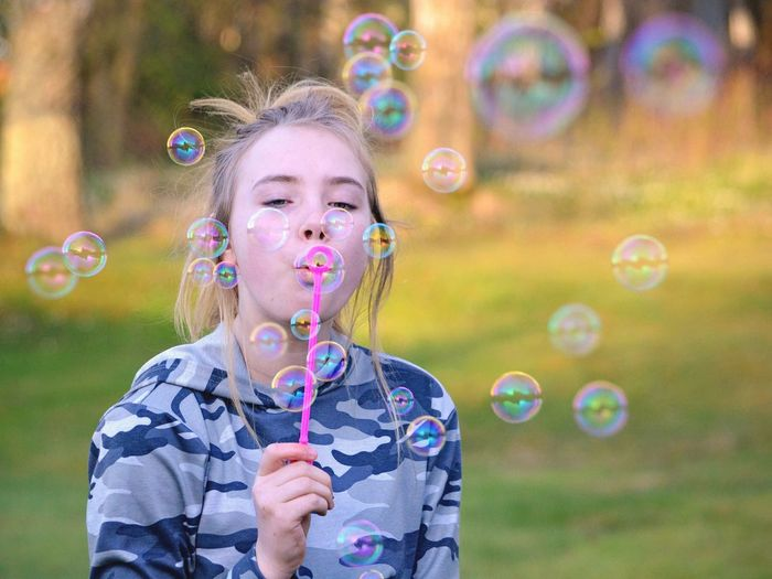 The Portraitist - 2017 EyeEm Awards Bubble Bubble Wand Blowing Soap Sud Leisure Activity Front View Fun Happiness Enjoyment Real People Playing Girl Portrait Outdoors Spring Springtime