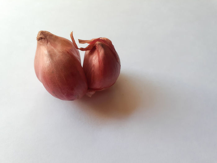 Close-up of red onion on a white background