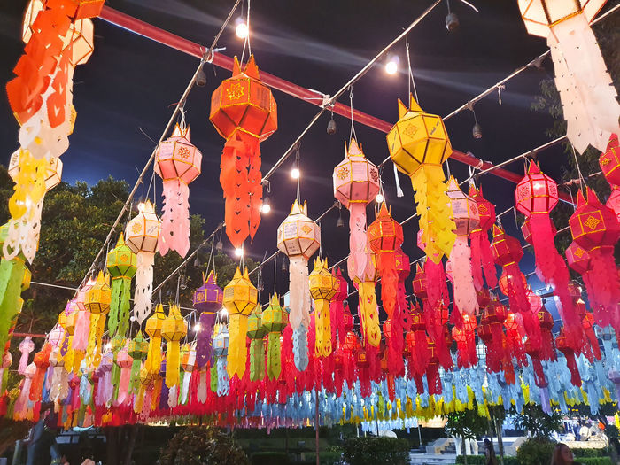 Low angle view of illuminated lanterns hanging in temple