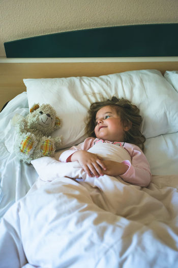 Little girl lying in a bed with teddy bear at the morning Lying Enoying 4-5 Years Relaxing Time Resting Teddybear Smiling Smile Pretty Toy Overhead View Cute Bedding Beautiful Beauty Home Happiness Happy Sheets Pillow Play Playing Daylight Day Morning Bedtime Bedroom Teddy Teddy Bear Bear Small Little Childhood Child Kid Girl Real People Indoors  One Person Bed Real Life Candid Moments Authentic Situation Authenticity The Portraitist - 2019 EyeEm Awards