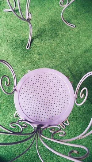 High angle view of metallic chair