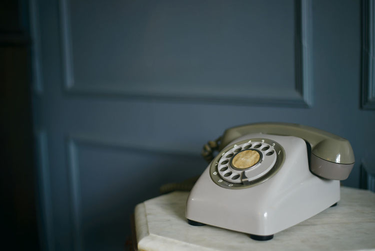 Close-up of telephone booth on table at home