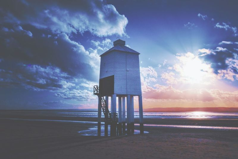 Sky Cloud - Sky Built Structure Sea Architecture Beach Water Tower Land Nature Horizon Over Water Beauty In Nature Horizon Building Exterior Scenics - Nature Sunset No People Dusk Tranquil Scene Outdoors