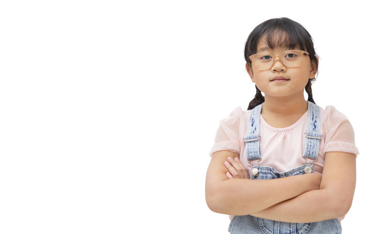 Portrait of girl against white background