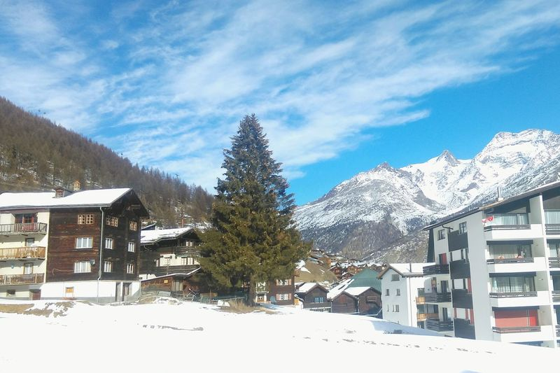 Snow Winter Cold Temperature Tree Sky Cloud - Sky Mountain Building Exterior Outdoors No People House Day Swiss Mountains Saasfee Travel Destinations Switzerland Snowy Mountains Travel Photography Travel Beauty In Nature
