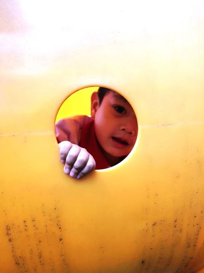 Portrait of boy peeking
