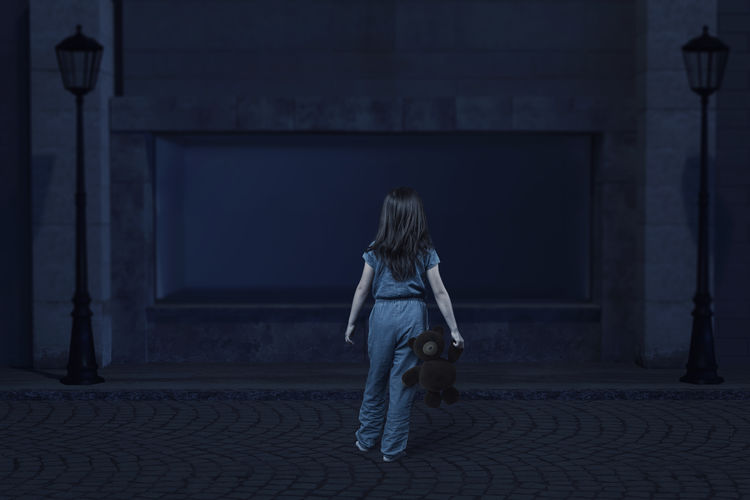 back of girl with teddy bear in the hand who get lost at the old city Back City Hopeless Standing Unhappy Abandoned Building Exterior Built Structure Child Childhood Darken Get Lost Girl Night Outside Street Teddy Bear Watching Around