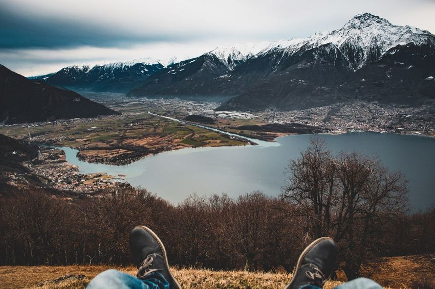 Mountain Low Section Human Leg Real People One Person Snow Nature Winter Shoe Leisure Activity Day Mountain Range Sky Outdoors Cold Temperature Beauty In Nature Lifestyles Water Lake Scenics Shades Of Winter
