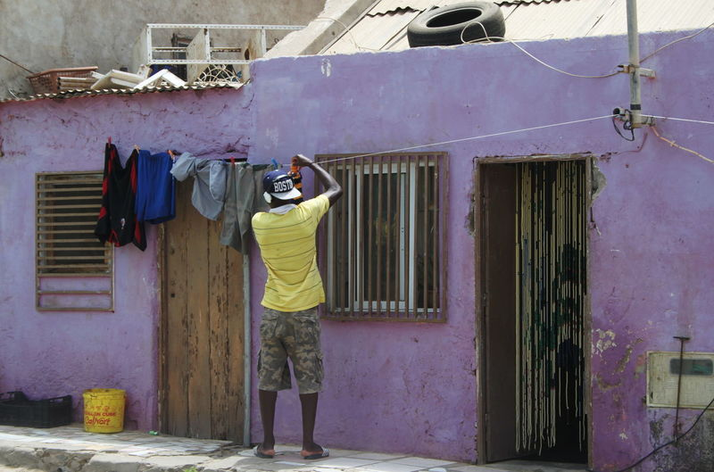 Architecture Building Exterior Built Structure Capo Verde Drying Espargos Full Length Hanging House Men Outdoors Real People Rear View Sal Island Summer 2015 Violet Color Working