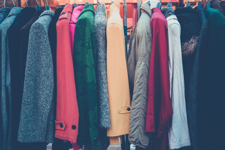 Various clothes hanging in store for sale