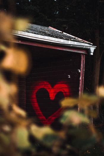 Close-up of heart shape on glass window