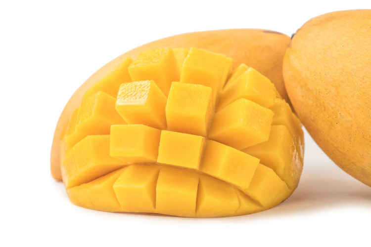Mango fresh fruit with cubes and slices. Isolated on a white background and clipping path. Mango Isolated White Background Fruit Food And Drink Cut Tropical Organic Ripe Healthy Eating Sweet Dessert Juicy Slices Cubes Yellow Natural Freshness Object Macro Studio Nutrition Diet Gourmet Vegetarian Exotic Clipping Path South Citrus  Vitamins Closeup Pieces Sliced Stone CutOut Half Pattern Close-up Studio Shot Food Indoors  Mango Fruit Group Of Objects No People SLICE Orange Color Medium Group Of Objects