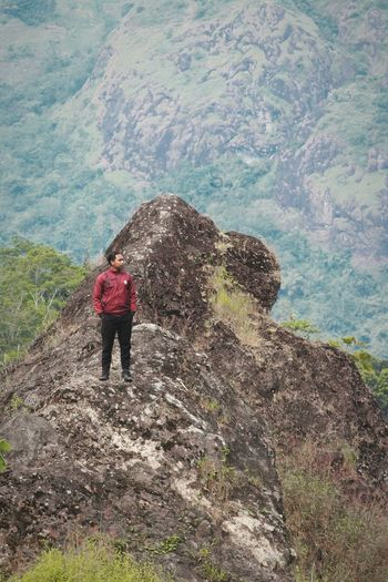 High angle view of man standing on mountain