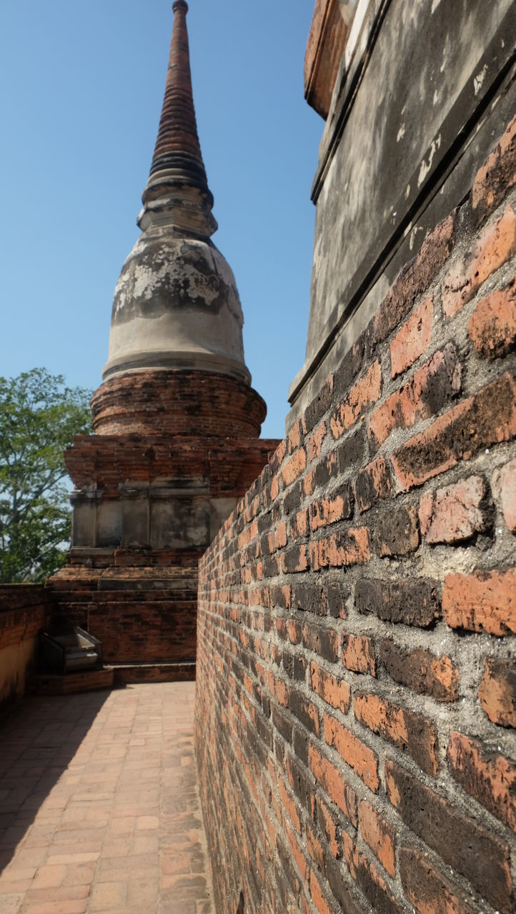 architecture, built structure, building exterior, brick wall, history, religion, travel destinations, no people, spirituality, outdoors, place of worship, day, low angle view, sky, ancient civilization