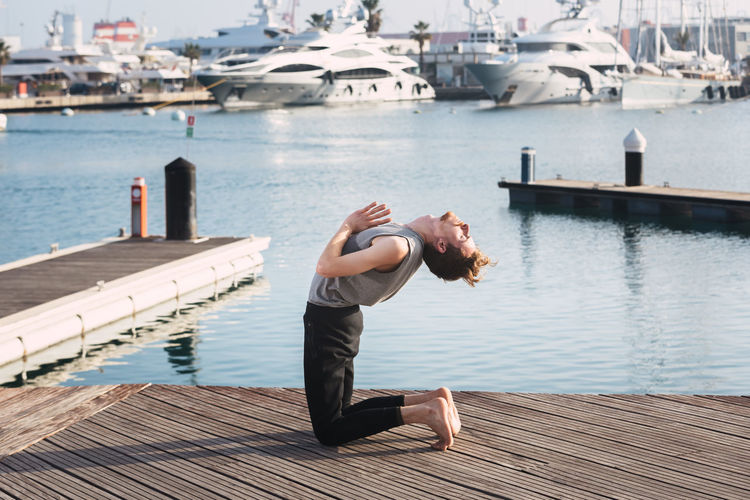 Man on pier over lake