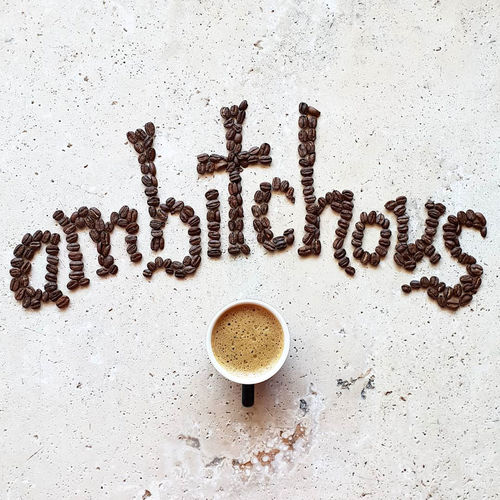 ambitchous Coffee Still Life Love Drink Espresso Lifestyle Hot Drink Coffee Time Cup Mood Text Coffee Art Message Indoors  Word Beans Ambition Communication Coffee Cup Freshness Coffee Beans Flatlay Directly Above Coffee - Drink Stone Material Single Word Coffee Bean Art Western Script Refreshment Mug No People Latte Capital Letter Indoors  Coffee Words