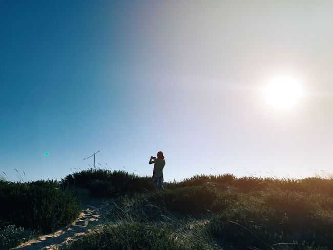 Photographing Photography Themes Technology Wireless Technology Real People Nature Leisure Activity One Person Standing Portable Information Device Smart Phone Grass Outdoors Camera - Photographic Equipment Mobile Phone Men Tranquil Scene Selfie Beauty In Nature Sky