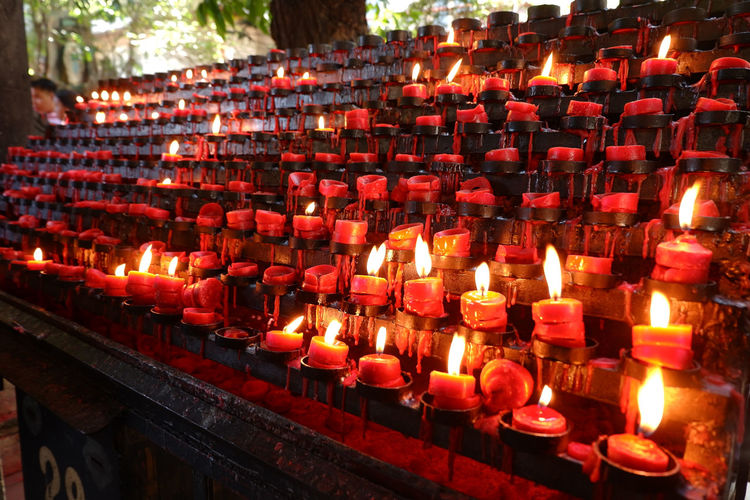 Pray, it works. Illuminated Flame Heat - Temperature Burning Religion Red Candle Glowing Close-up