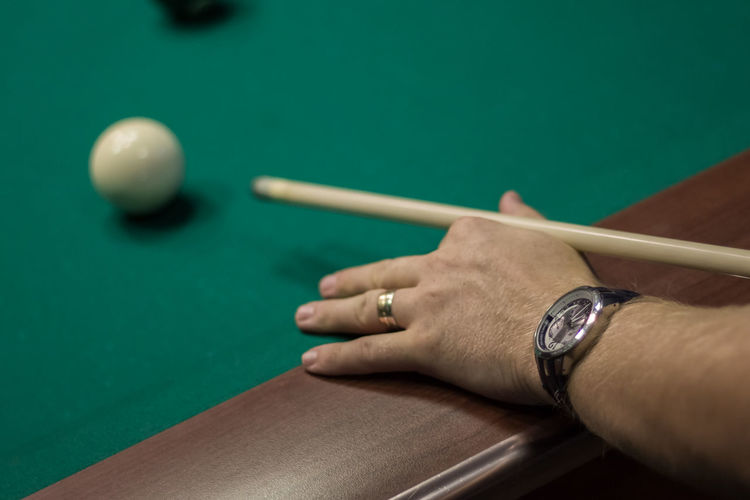 Close-up of hand playing snooker