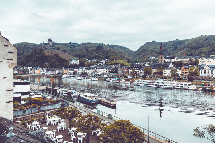 View to the city and castle of Cochem over the river Mosel, Rheinland-Pfalz, 3rd May of 2019. Germany Mosel Building Exterior Architecture Built Structure Water Building Sky City Nature Nautical Vessel Transportation Day Mode Of Transportation No People Outdoors Cochem Cochem An Der Mosel Cochem Castle Mountain Cloud - Sky High Angle View Residential District Cityscape Mountain Range TOWNSCAPE Tower