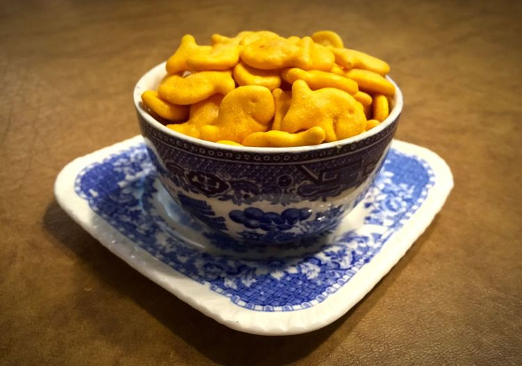 Goldfish in a bowl Bowl Bowling Close-up Cracker Craker Elevated View Focus On Foreground Food Freshness Goldfish Indulgence No People Organic Ready-to-eat Selective Focus Snack Still Life Yellow