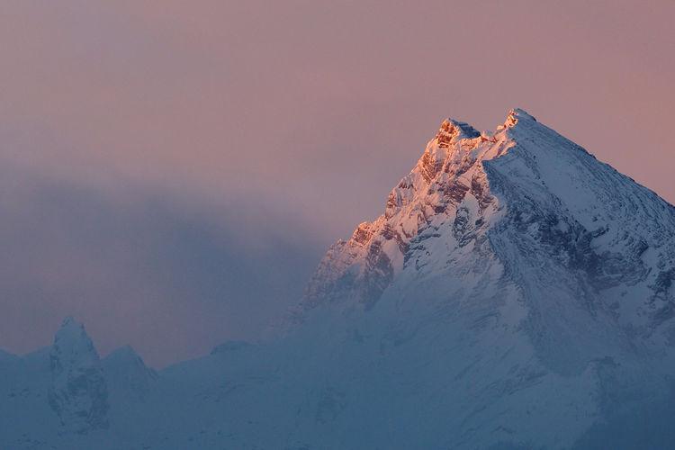 Peak of mt. watzmann hocheck and mittelspitze at sunrise in winter, bavarian alps, germany