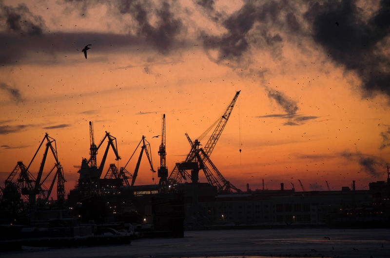 Bird Water Oil Pump Sunset Cityscape City Commercial Dock Sea Industry Urban Skyline Smoke Stack Shipyard Emitting Industrial District Crane - Construction Machinery Industrial Ship Pollution Atmospheric Romantic Sky Lightning Air Pollution Container Ship Barge Cargo Container Chimney