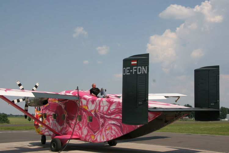 Airplane Day Fuel Station Fueling Outdoors Pink Pink Color Pink Skyvan Sky Skyvan