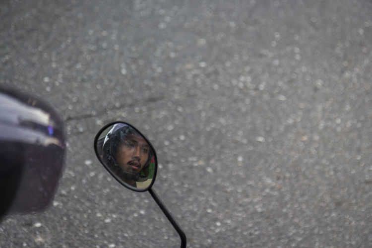 face of moterbike driver on side mirror Candid Candidshot Day Driver Face Leisure Activity Lifestyles On The Road Outdoors Reflection Selective Focus Side Mirror Snapshot Space Street Street Photography Streetphoto Streetphotographythailand Streetshot Streetthailand