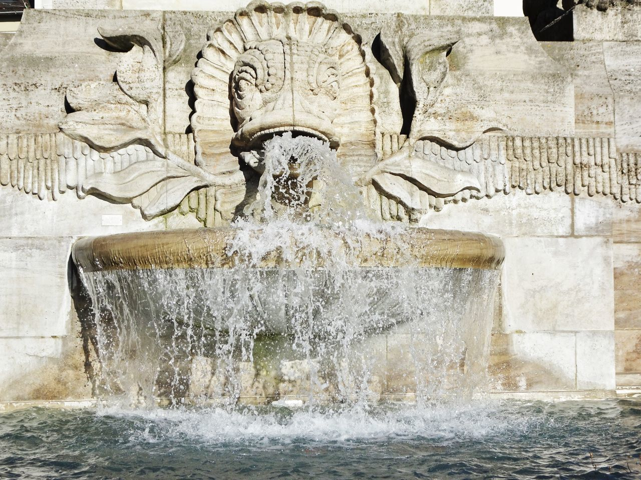 water, fountain, motion, statue, sculpture, art and craft, human representation, splashing, outdoors, day, waterfront, no people, spraying, architecture, nature