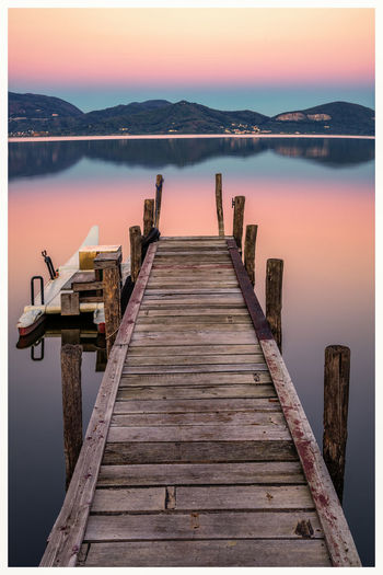 Sunset on Lake The Week On EyeEm Www.alexander-schitschka.de Water Nature Mountain Clear Sky Travel Destinations Landscape Long Exposure Lake View Tuscany Reflection Toskana Toscana Italy See Alps Pier Sonnenuntergang Sunset
