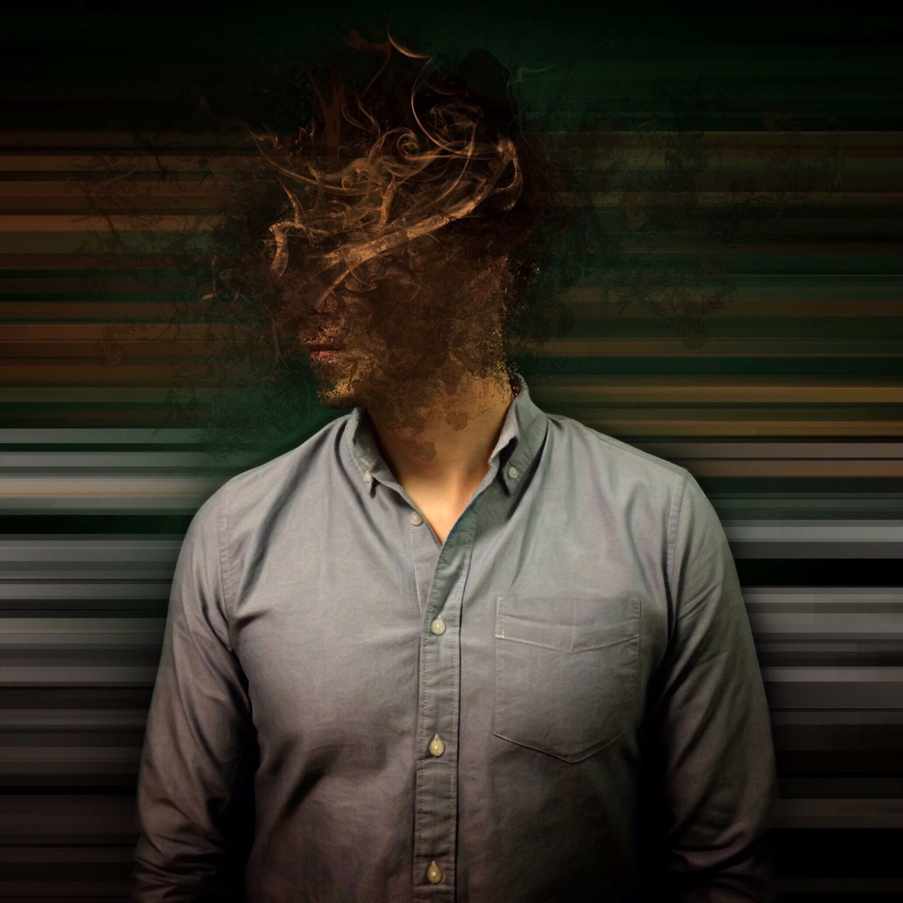 Man With Obscured Face Standing Against Patterned Wall